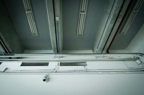 camera white CCTV camera on white wall security