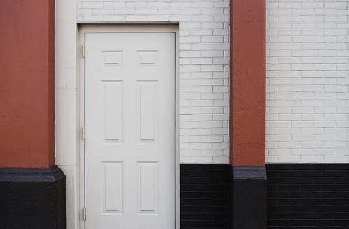 brick white wooden 6-panel door new york