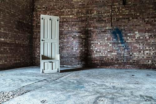 door white wooden 6-panel door in room wall