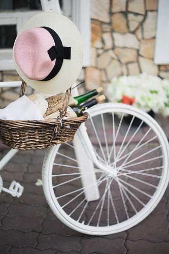 photo bicycle brown wicker basket with white, pink, and black sunhat besides white bike bike free for commercial use images