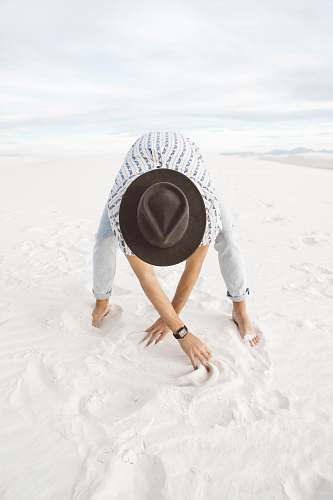 white sands person standing on sand crawling
