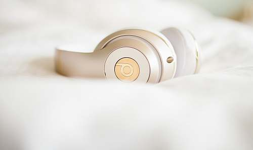 headphone gold edition Beats by Dr.Dre wireless headphones on top of white textile beats headphone