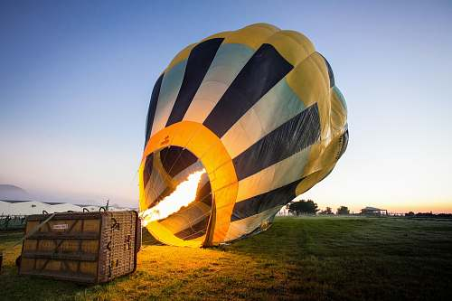 photo fire yellow and blue hot air balloon at daytime sunrise free for commercial use images
