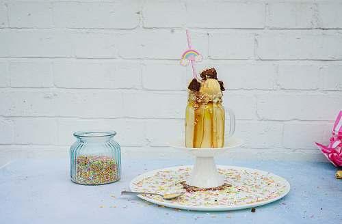 person caramel milkshake jar