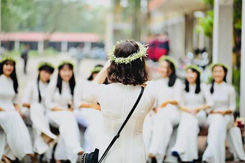 people group of woman wearing white dresses person