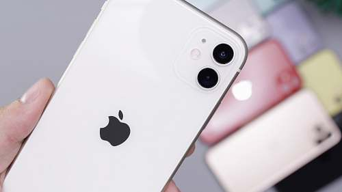 person white iPhone 11 Pro Max cell phone