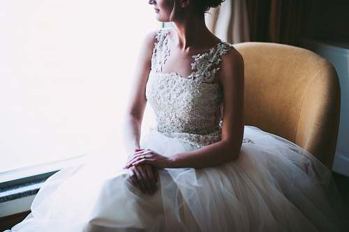 people woman in white wedding dress sitting near window person