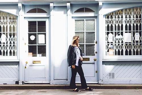 people woman standing beside the door person