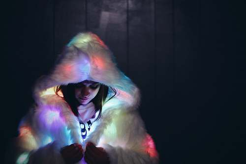 person woman wearing lighted furry coat people