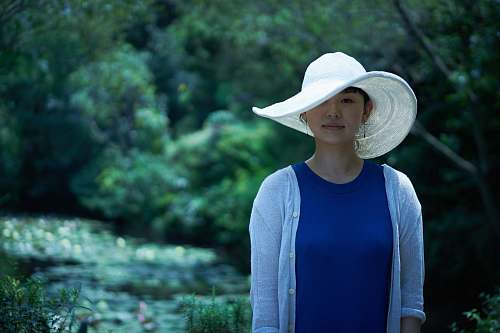 person woman wearing sun hat and cardigan hat