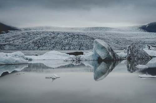 grey ice berg on body of water glacier