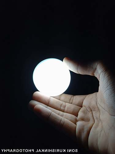 human person holding ball of light person