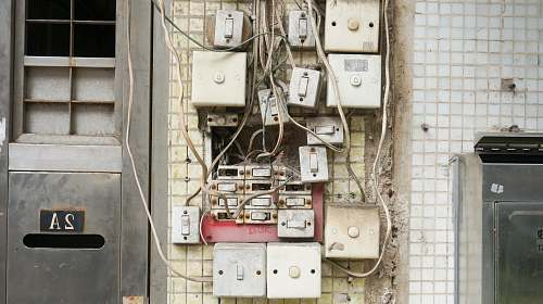 wiring several assorted power switches mounted on white wall switch