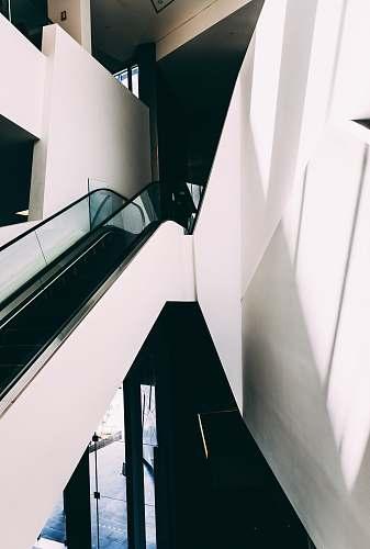 australia white and black escalator inside building indoors