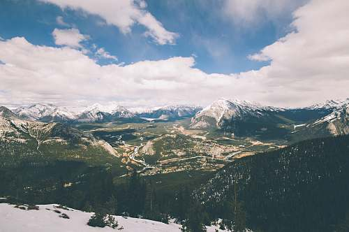nature aerial photography of mountains under white cloudy skies outdoors