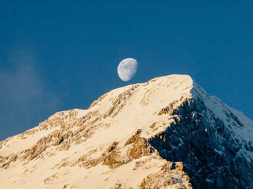 moon brown mountain under blue sky grindelwald