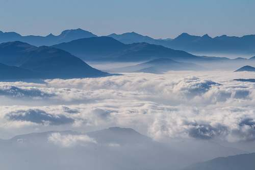 nature gray mountains surrounded by clouds in aerial photography cloud