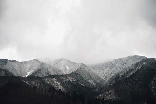 nature grayscale photo of mountain at daytime alps
