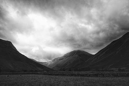nature greyscale photo of hills black-and-white