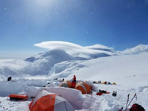 snow group of people camping on snow mountains tent