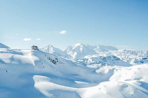 snow house on top of snow covered hills and mountains during day nature