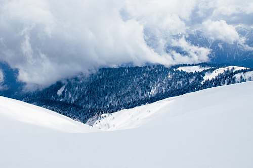 nature landscape photography of snow covered hill clouds