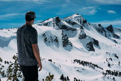 person man looking at snow mountain snow