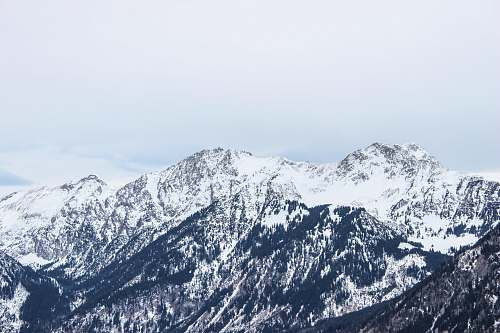 alps mountain covered by snow at daytime nature