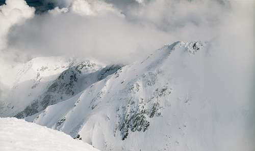 snow mountain covered with snow grey