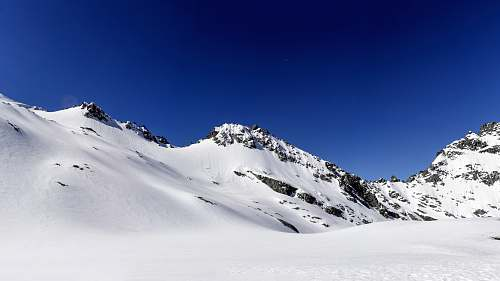 nature mountain covered with snow under blue sky new zealand