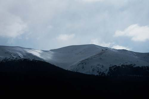 grey snow covered mountain mountain range