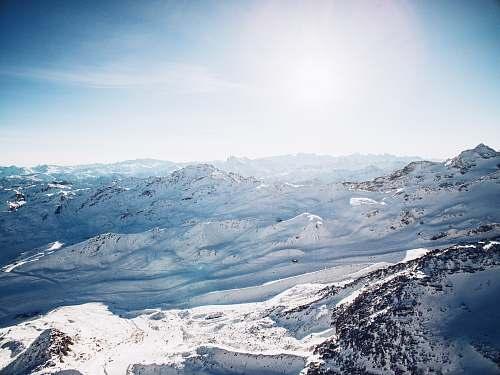 nature snow mountain under white sky snow