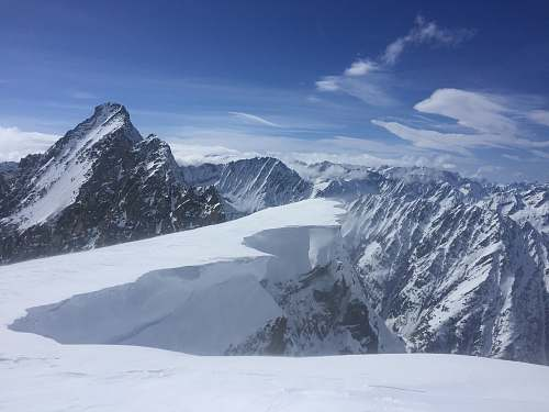 nature snowcap mountains during daytime snow