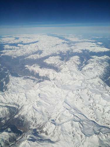 outdoors aerial view of snow covered mountain ranges scenery