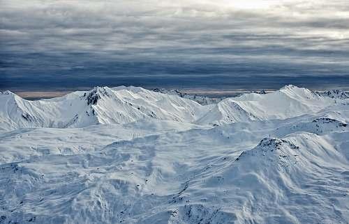 mountain bird's-eye view photography of snow mountain snow