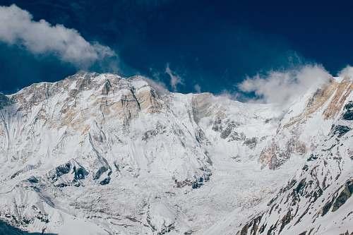 mountain glacier mountain under white and blue sky snow
