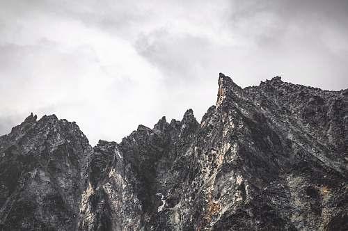 outdoors gray rocky mountain under cloudy sky mountain