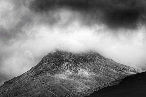 black-and-white grayscale photo of foggy mountain mountain