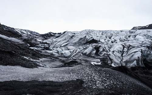 mountain grayscale photo of mountains iceland