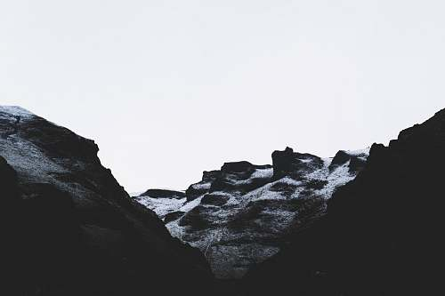 mountain grayscale photo of rock formation alps