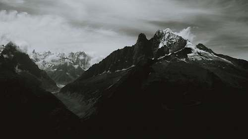 mountain grayscale photography of alps outdoors