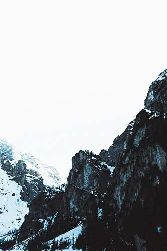 outdoors high-angle photography of rock mountains during winter mountain