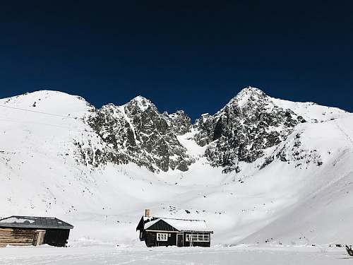 outdoors houses and snow-covered mountain building
