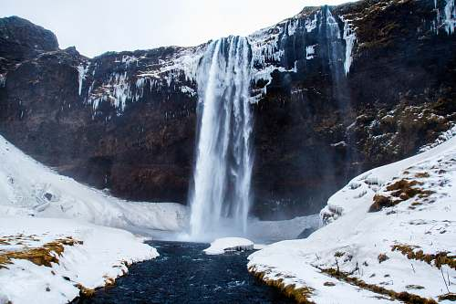 snow low-angle photography of waterfalls during winter ice