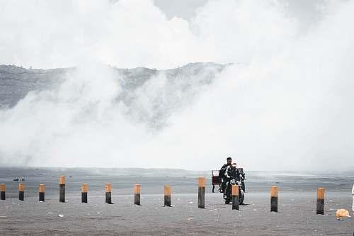 human man riding motorcycle person