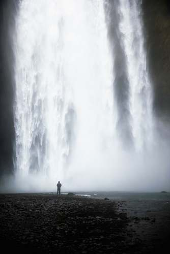 outdoors man standing in front of waterfalls water