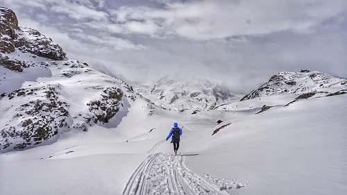 mountain person walking on snowy mountain snow