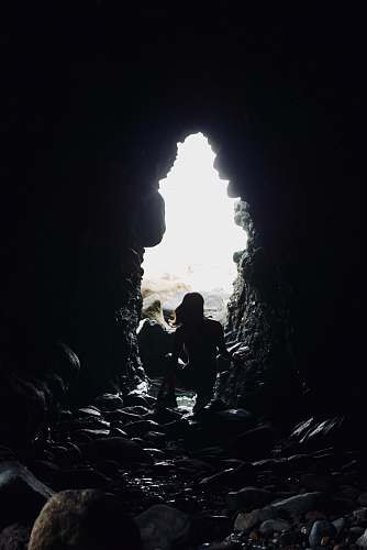 human silhouette of person on tunnel cave