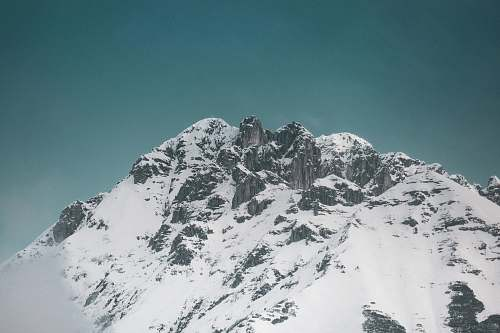 mountain snowy mountain under calm blue sky mountain range