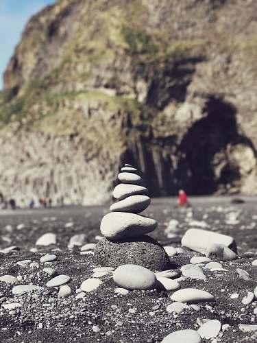 landslide stack of stone at shore near rockways rock